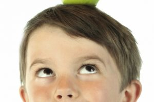 child having aha moment looking up at apple
