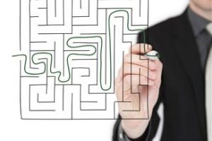 Business Coaching Tools shown by Man Finding Way out of maze