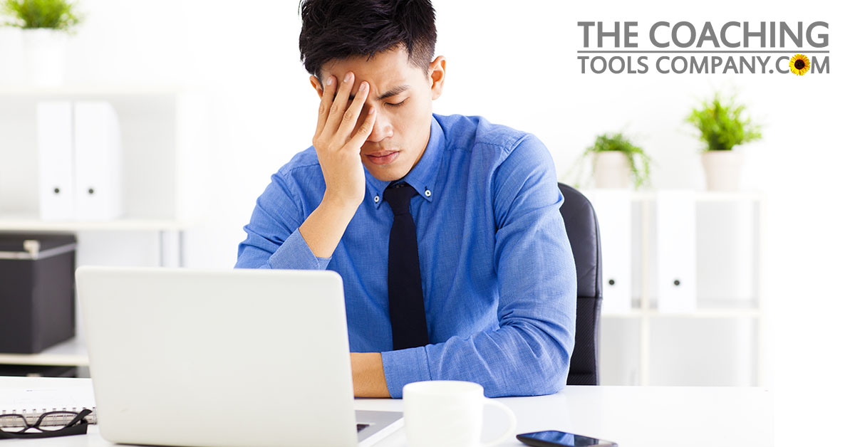 Stressed out Client in the Office with laptop and phone