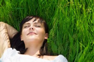 Authentic Happiness: Woman, smiling, eyes closed lying in grass!