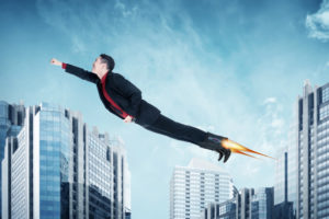 New Career Coaching Image - Businessman flying with rockets on shoes by leolintang from Shutterstock