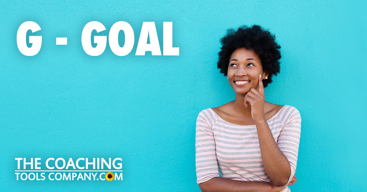 GROW model goal setting with happy woman looking up and contemplating goals