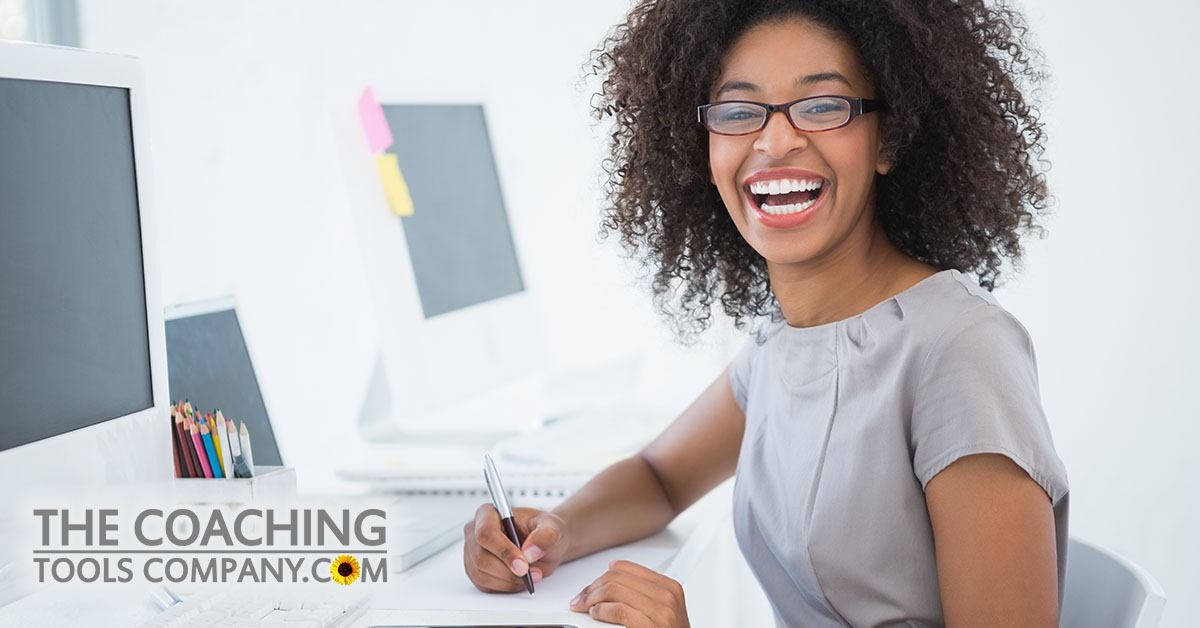 Happy Client Using Goal Setting Tips at Desk