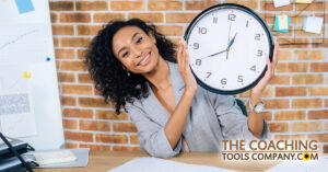Happy Client Holding Clock at desk for Time Management